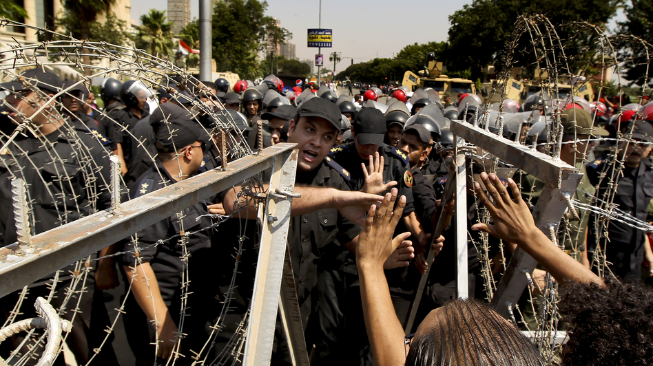 An Egyptian military police officer argues with protesters during a demonstration on June 14, 2012, outside the Supreme Constitutional Court in Cairo. (AFP/Getty Images)