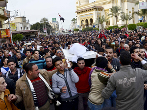 Egyptians carry the body of a person killed in clashes between police and protesters in Mansura on March 2. Mansura is the latest province to launch a campaign of civil disobedience, following in the footsteps of the canal cities of Port Said, Ismailiya and Suez.