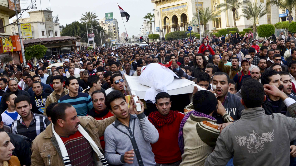 Egyptians carry the body of a person killed in clashes between police and protesters in Mansura on Saturday. Mansura is the latest province to launch a campaign of civil disobedience, following in the footsteps of the canal cities of Port Said, Ismailiya and Suez. (AFP/Getty Images)