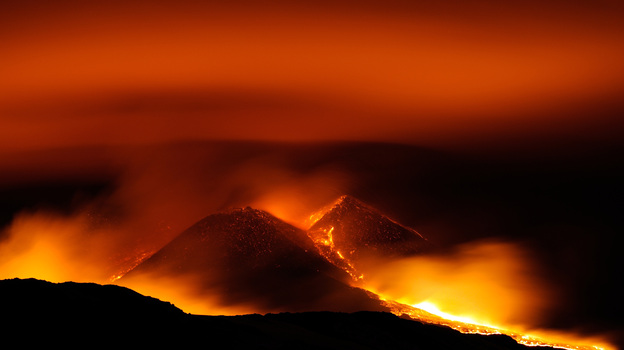 The sky glowed red above Sicily's Mount Etna early Wednesday.