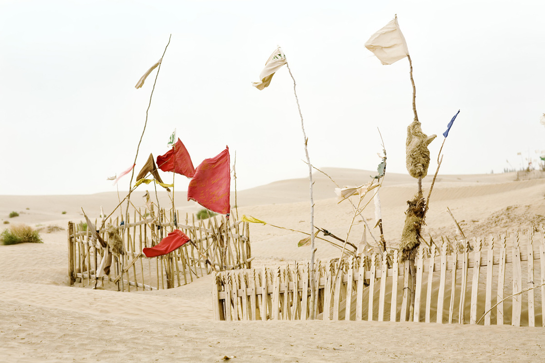 Unrevealed, Site 2 (Red Movement), 2009. Interconnected by wind and sand: tulums, branches, mazars and saints.