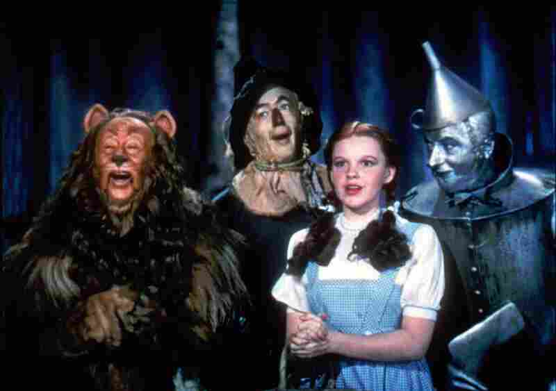 Bert Lahr as the Cowardly Lion, Ray Bolger as the Scarecrow, Judy Garland as Dorothy, and Jack Haley as the Tin Man in the best-known version of The Wizard Of Oz