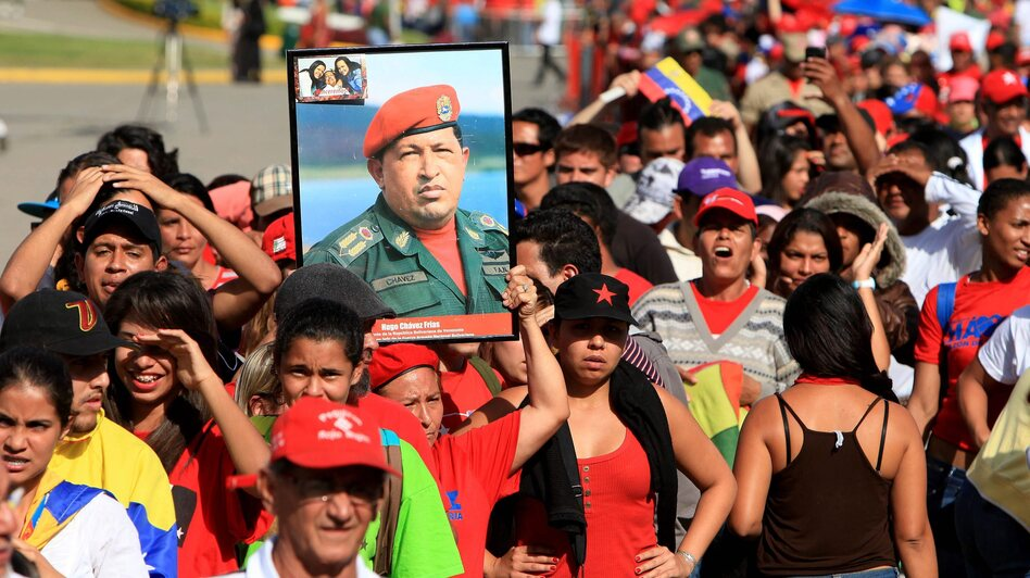 Supporters of late Venezuelan President Hugo Chavez wait in line to see his body lying in state Thursday outside the Military Academy in Caracas, Venezuela. The state funeral will be held Friday.
