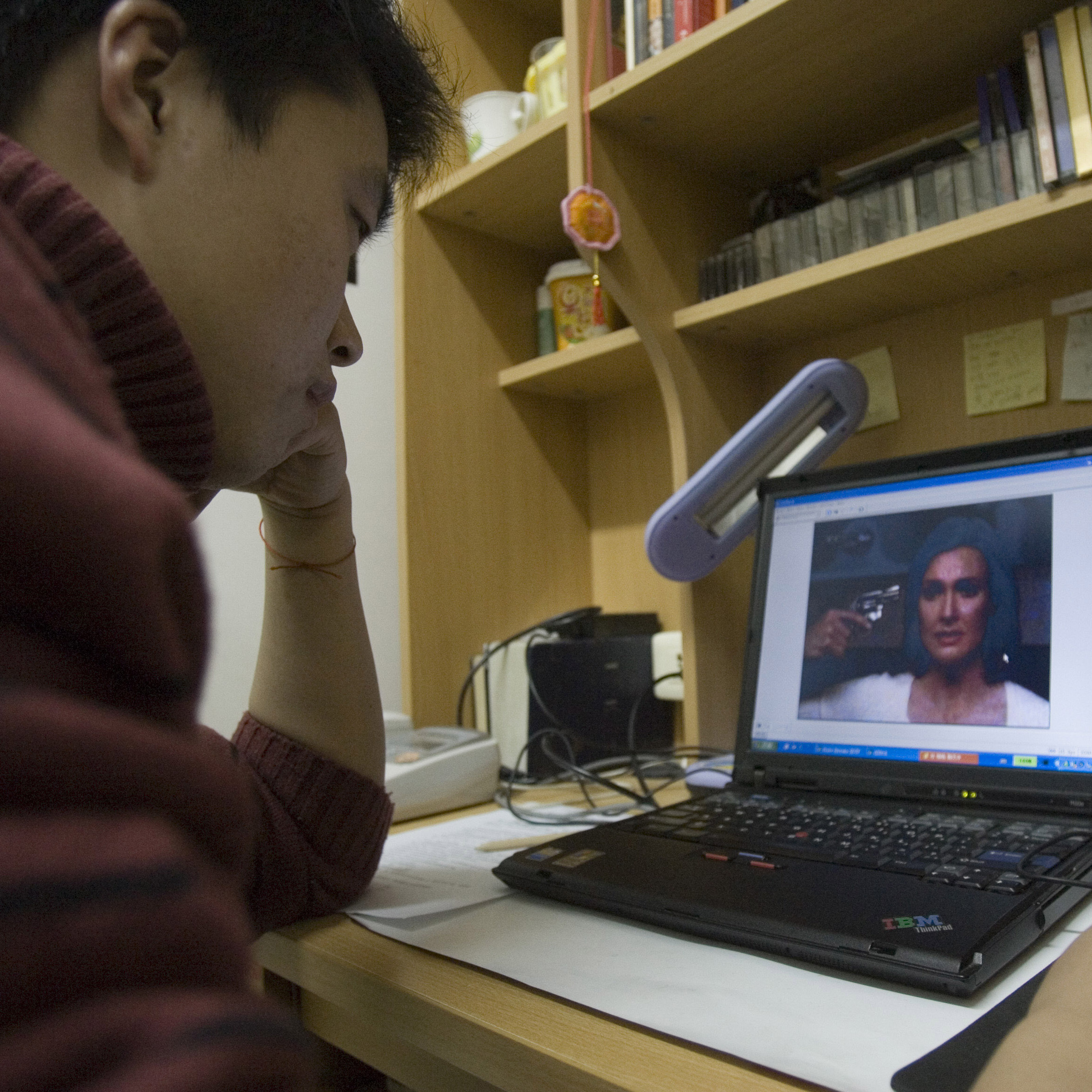 A student at Peking University watches an episode of American TV series Desperate Housewives online in Beijing on Dec. 19, 2005.