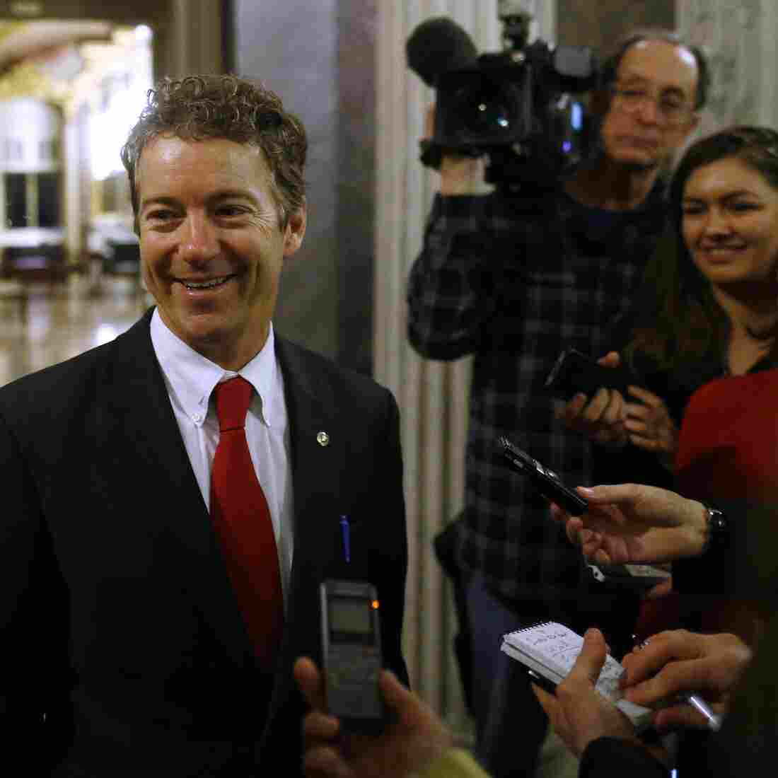 Kentucky Sen. Rand Paul leaves the floor of the Senate early Thursday following his filibuster of the nomination of John Brennan to be CIA director.