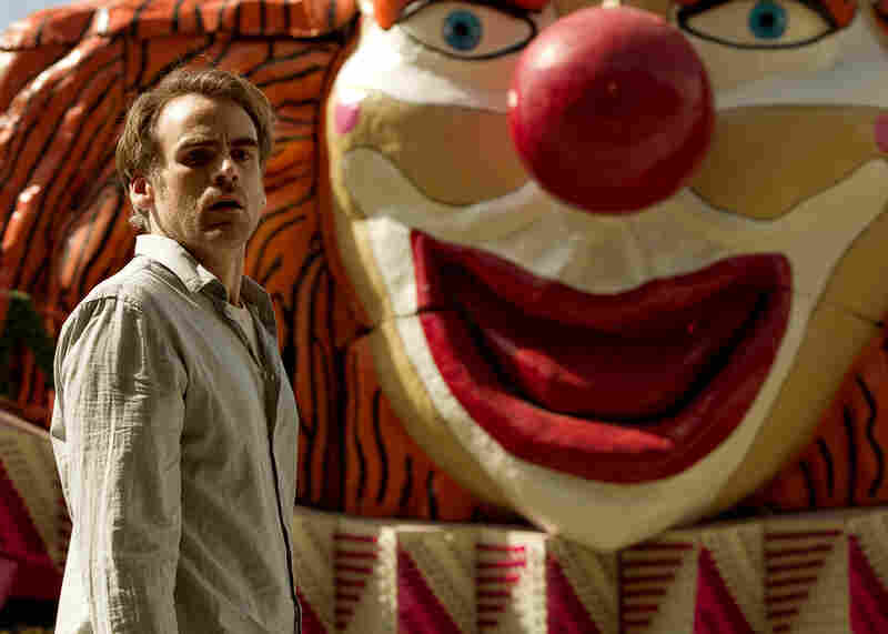 Although the bizarre amusement park motif that runs through The Silence is a bit surreal, the unsettling effect meshes neatly with the film's plot (Pictured: Sebastian Blomberg).