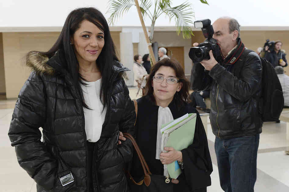 Bouchra Bagour, left, leaves a court house with her lawyer Gaelle Genoun.