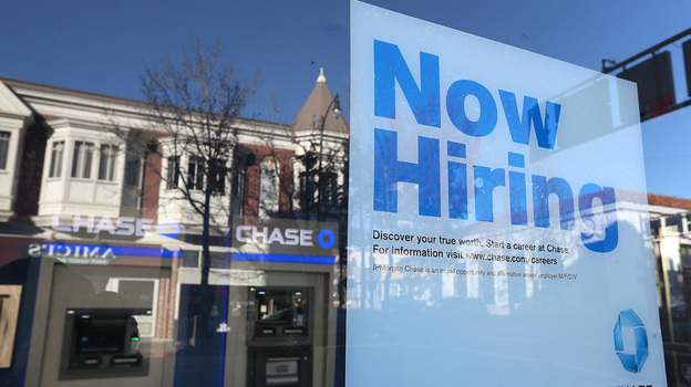 The job market showed strong growth in February. But questions about low wages, consumer debt and government austerity cloud the sunny picture. (Getty Images)