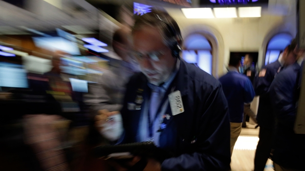 Trader Warren Meyers works on the floor of the New York Stock Exchange on Friday. Stocks opened higher after the government reported a burst of hiring last month that sent the unemployment rate to a four-year low. But both the White House and congressional Republicans reacted to the news in less than celebratory fashion. (AP)