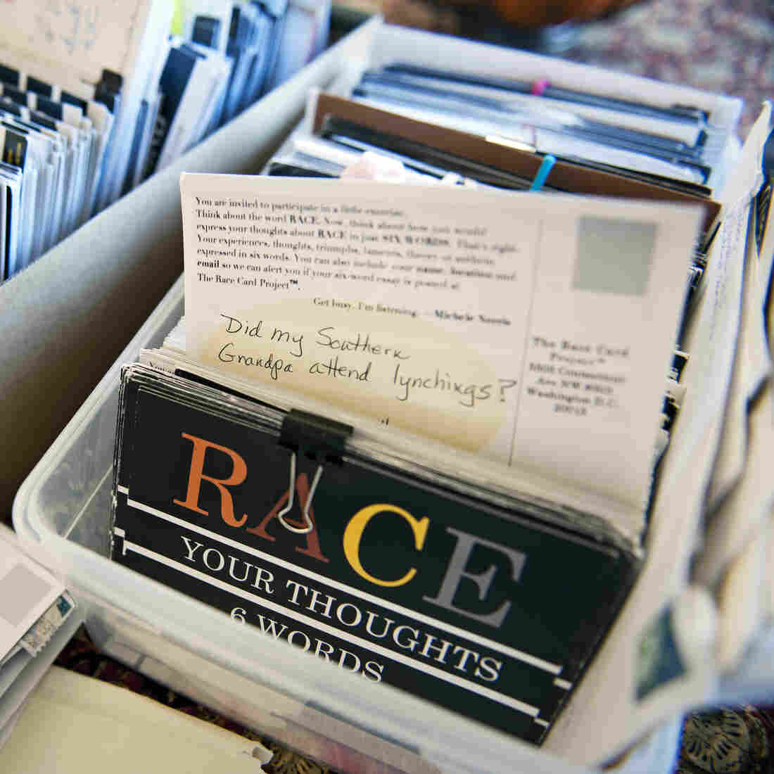 NPR's Michelle Norris displays some of the Race Cards sent to her as part of her Race Card Project, at her home in Washington, on Nov. 29, 2012. Norris was on a book tour two years ago, and started passing out postcards a dozen or so at a time, asking people to share six words that express their thoughts about race. Now she has received more than 12,000 cards.