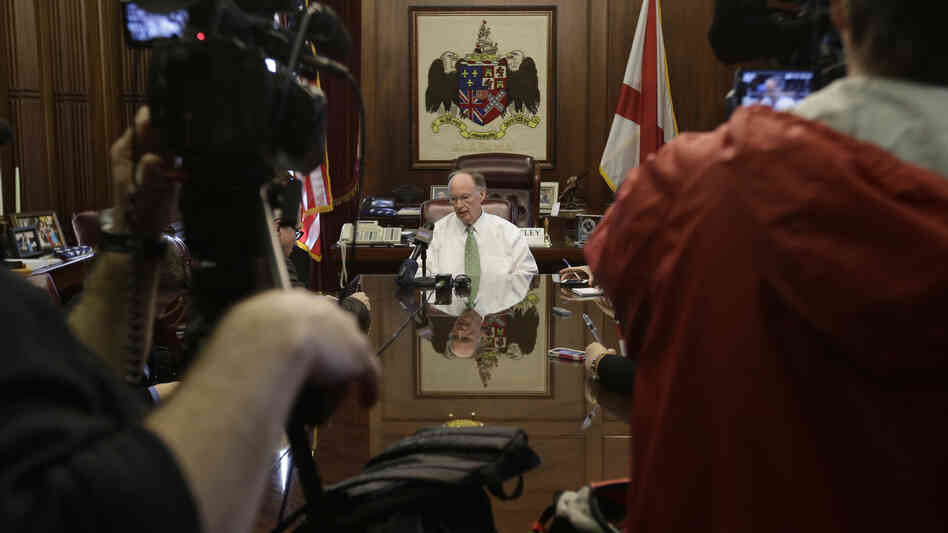 Gov. Robert Bentley talks with reporters in his office, one day after Alabama Republicans adopted legislation to provide state tax credits to atte