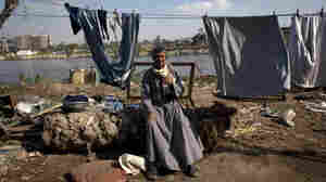 An Egyptian farmer drinks tea  near his home on Qursaya island, in the Nile River, next to Cairo, in January. The Egyptian military says it is the registered owner of the island's land, a claim disputed by the farmers and fishermen who live there.