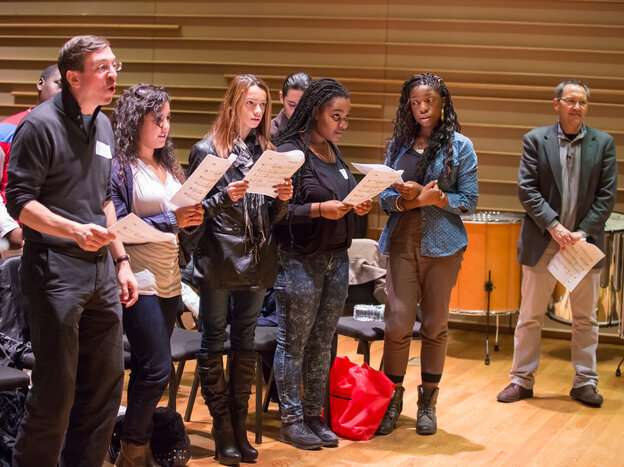 A coach and high school students work on Osvaldo Golijov's Passion According to St. Mark with the composer (right) in November 2012.