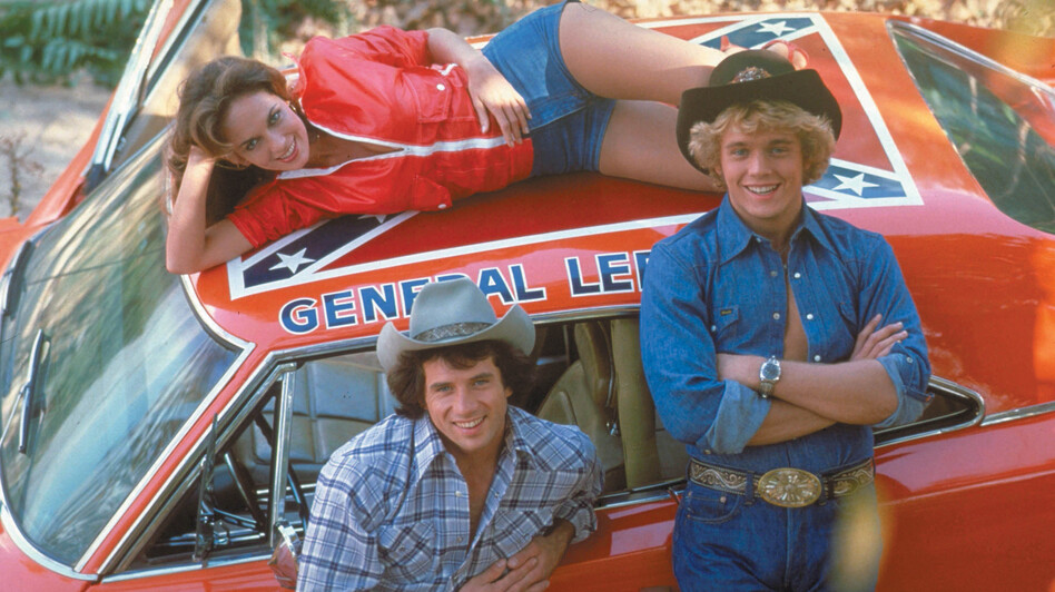Tom Wopat (left), John Schneider and Catherine Bach played Luke, Bo and Daisy Duke — rowdy country cousins in a Georgia town — in the '80s TV series The Dukes of Hazzard. (The Kobal Collection)