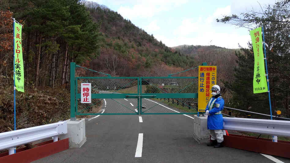 A road leading back to the Togawas' old home in the seaside village of Namie is closed due to radioactive contamination.