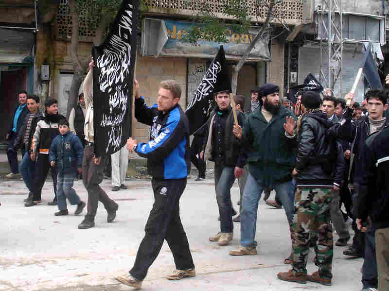 Islamists from Jabhat al-Nusra stage a protest in the Syrian town of Kfar Nabel. Until recently, the group has been reluctant to appear in public.