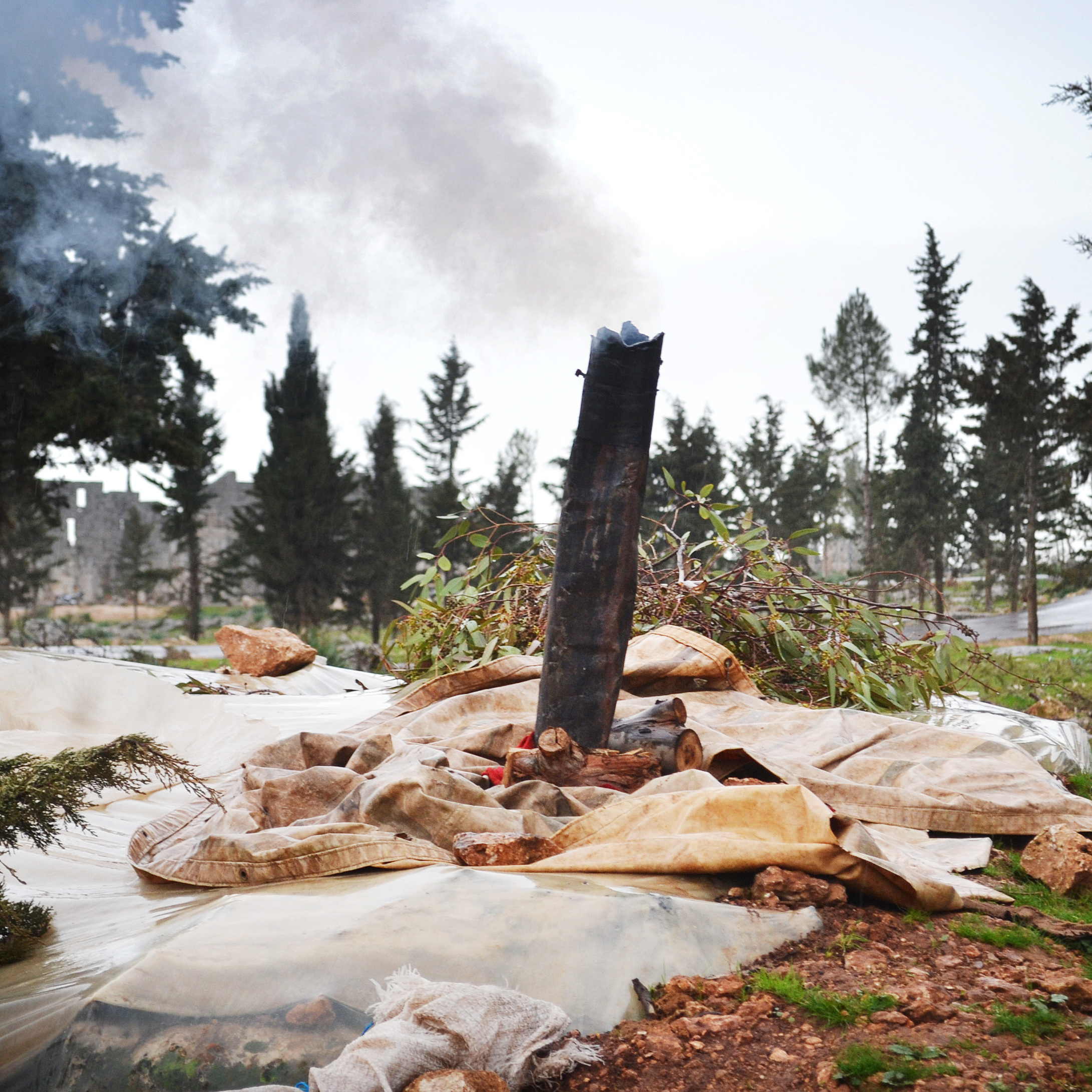 Smokestacks mark the underground dwellings of Syrians fleeing fighting in their hometowns.