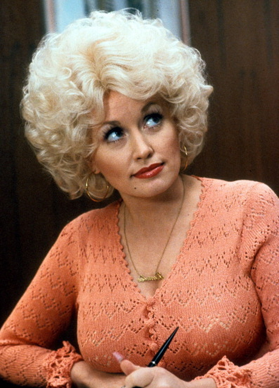 Dolly Parton in a scene from the film <em>9 to 5.</em>