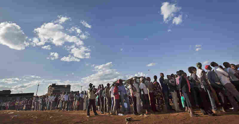 Voters queued for hours across Kenya as old-fashioned paper ballots had to be rushed to polling stations.