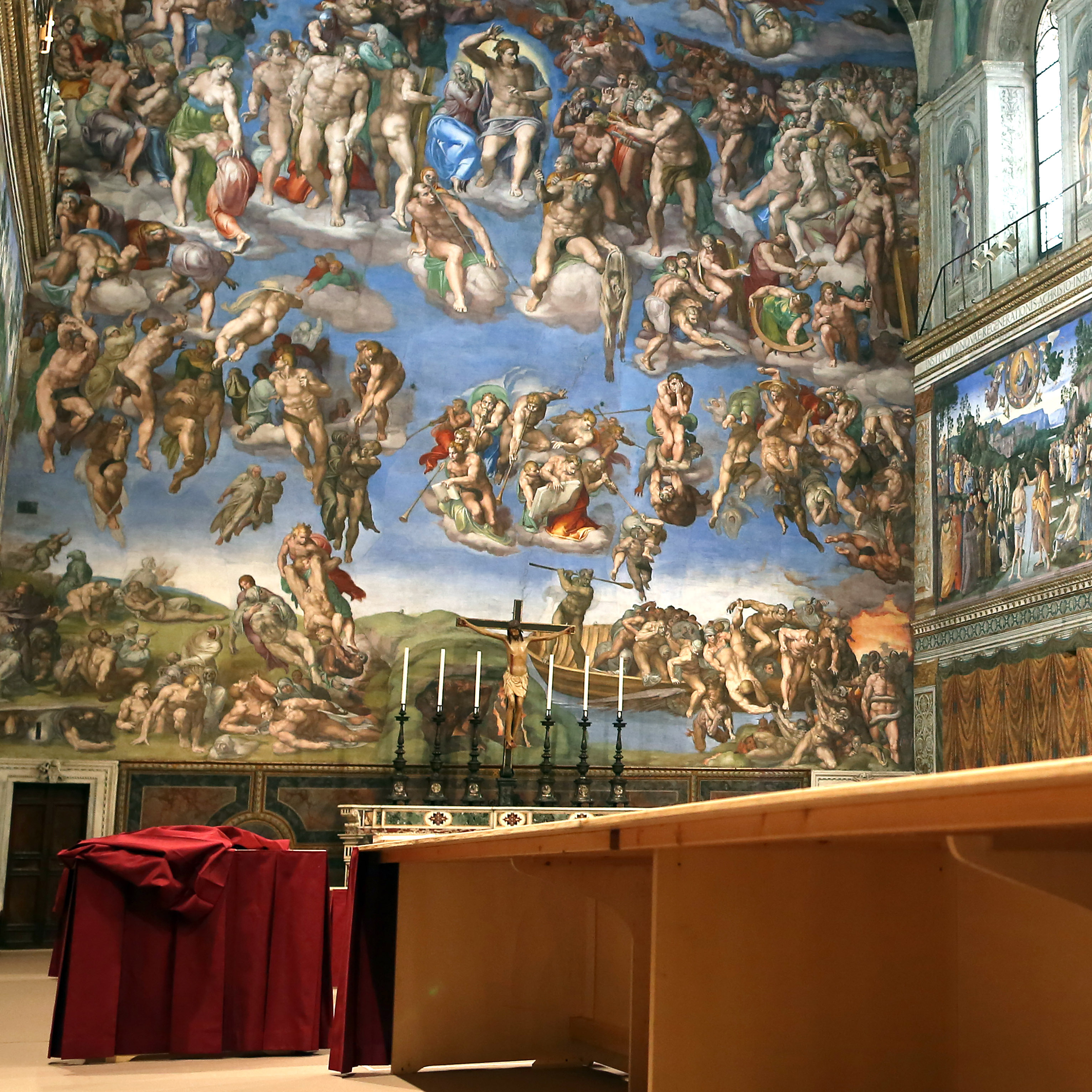 The Sistine Chapel is being prepared for Tuesday's papal conclave at the Vatican.