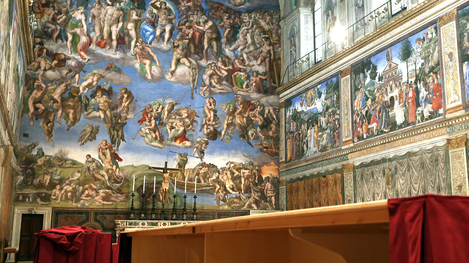 Furniture is prepared inside the Sistine Chapel before Tuesday's papal conclave in Vatican City, Vatican on Saturday.