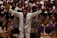 With his <em>St. Mark Passion,</em> composer Osvaldo Golijov turns the traditional Passion (like those of J.S. Bach) on its head and gives it a spin or two. Here, Javier Silva performs in front of the Forest Hills High School Concert Choir, the Frank Sinatra School of the Arts Concert Choir and Songs of Solomon at Carnegie Hall.