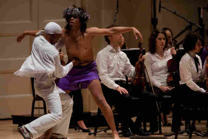 Deraldo Ferreira, left, pierces Jesus, played by Afro-Cuban singer and dancer Reynaldo Gonzalez-Fernandez.