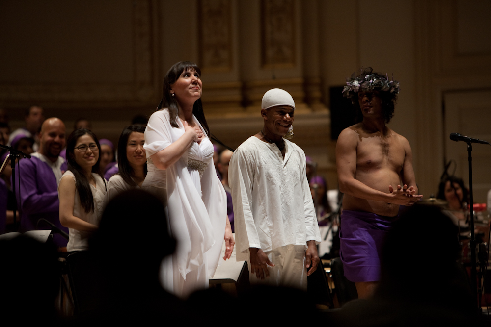 Soprano Jessica Rivera, left, Deraldo Ferreira, center, and Renaldo Gonzalez-Fernandez received enthusiastic applause after performing in Osvaldo Golijov's Passion according to St. Mark, with Orquesta La Pasion and conductor Robert Spano at Carnegie Hall, March 10, 2013.