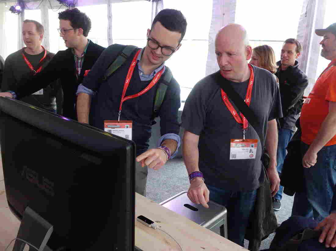 SXSW 2013 festival attendees test out Leap Motion's motion-controlled device, which allows users to interact with computers by gesturing.