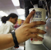 A customer fills a 21-ounce cup with soda at a New York City McDonald's.