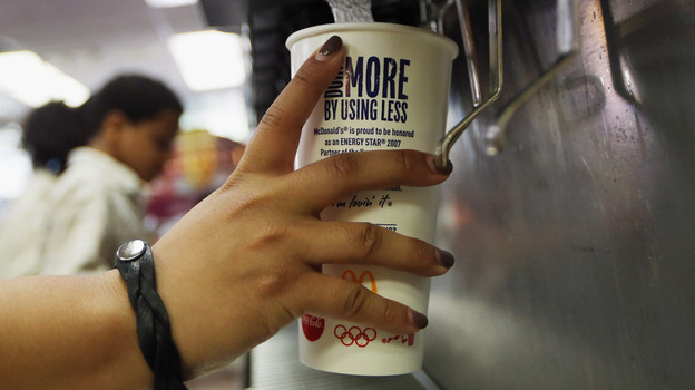 A customer fills a 21-ounce cup with soda at a New York City McDonald's. (Getty Images)
