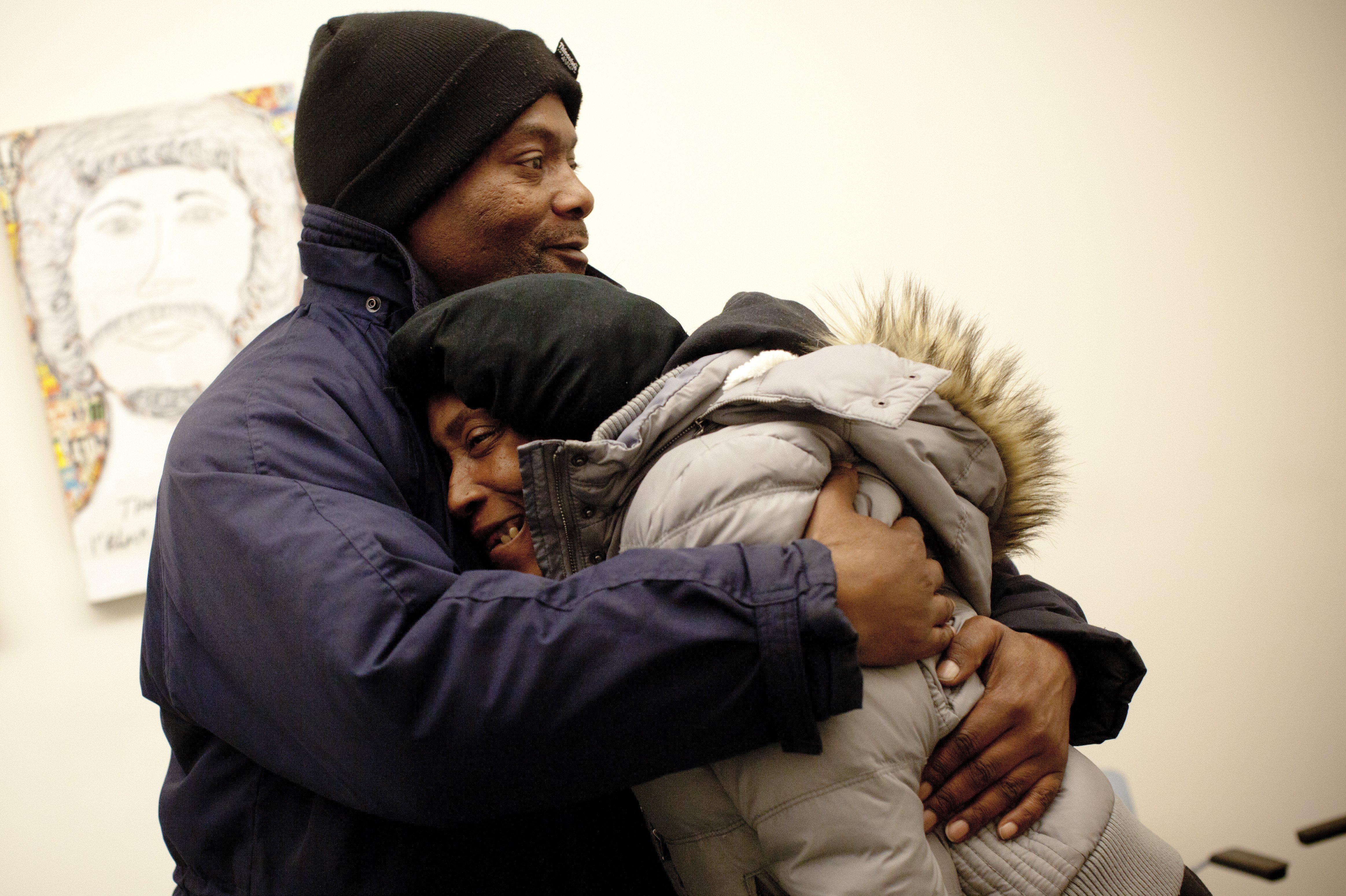 Simmons hugs Evelyn inside HCH. He has been trying to help the Hearnes and many others get off the streets.