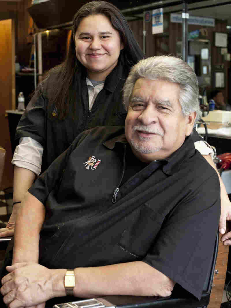 Richard Piña and his youngest daughter, Alex, both work at Rich's Den in Calumet City, Ill. Pina bought the barbershop a few years before he retired from the Chicago police force.