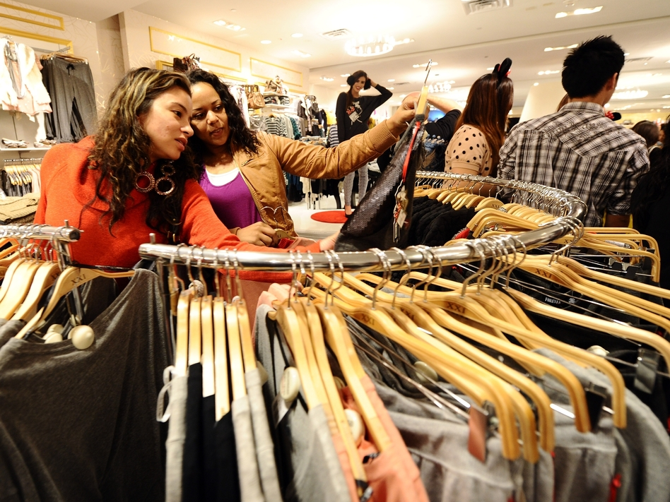 "Prices at stores like Forever 21 are so low, ""it's virtually impossible to walk out empty-handed,"" says Elizabeth Cline, who writes about fast fashion."