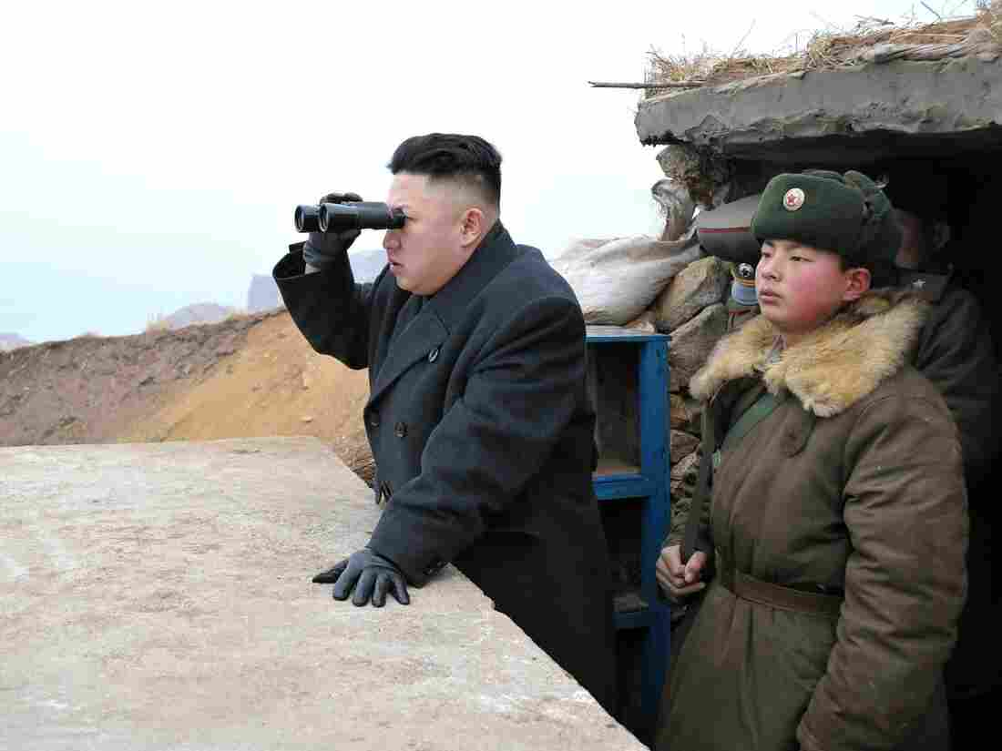In this image released by North Korea's Central News Agency, leader Kim Jong Un is said to be using a pair of binoculars to look south during an inspection of a  front-line army unit.
