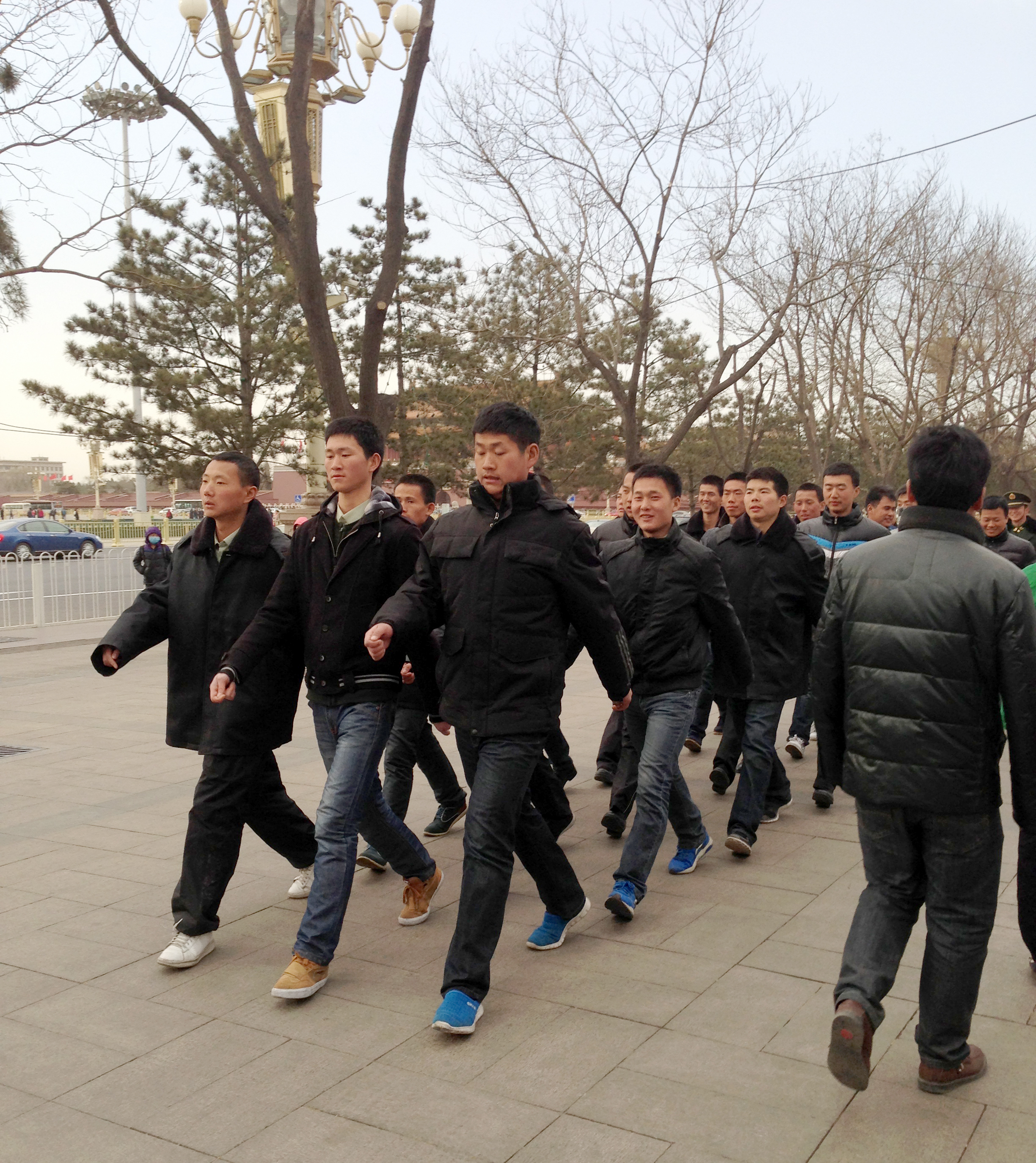 Just another day in Beijing: Plainclothes policemen make the rounds near Tiananmen Square, where the annual meeting of the country's National People's Congress is under way.