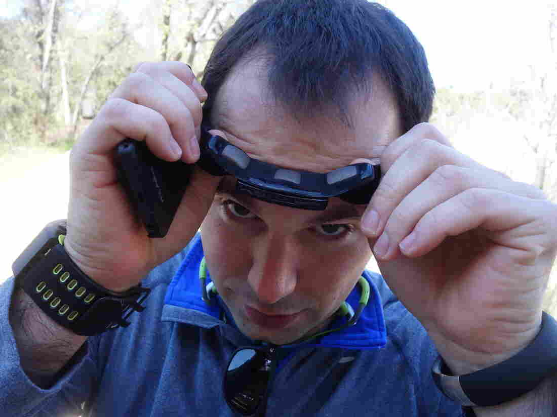"""Noah Zandan shows off his Zeo sleep-tracking headband. His other self-tracking devices are on his wrists. Noah and his father, Peter, are both part of the growing """"Quantified Self"""" movement."""