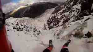 Mark Roberts' feet, in the foreground, as he slid down a mountain in Wales.