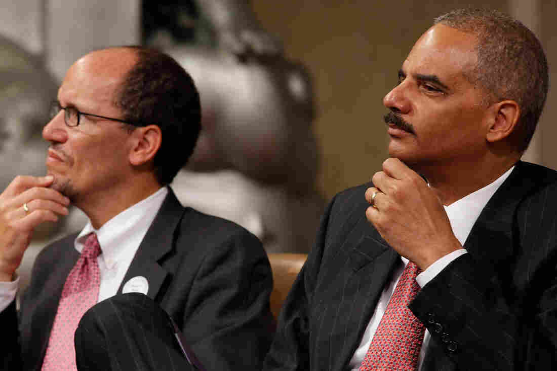 Attorney General Eric Holder (R) and Assistant Attorney General for the Civil Rights Division Thomas Perez in 2010 in Washington, D.C.