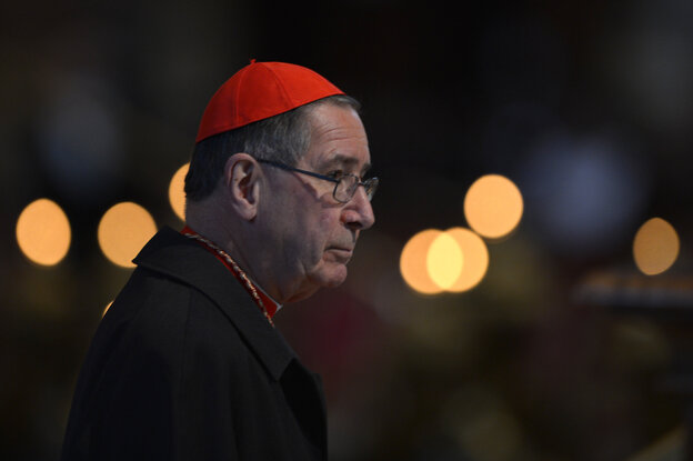 Cardinal Roger Michael Mahony arrives to attend a mass at St Peter's basilica on March 12, 2013 at the Vatican.