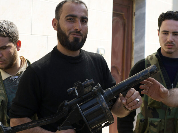 A Syrian rebel in the city of Kfar Nbouda holds a grenade launcher in February, part of a recent weapons shipment to the rebels by the Saudi government. Arms are not the only thing flowing from Saudi Arabia to Syria
