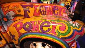 "Paintings adorn the ""Magic Bus"" on display at a museum built on the site of the 1969 Woodstock music festival."