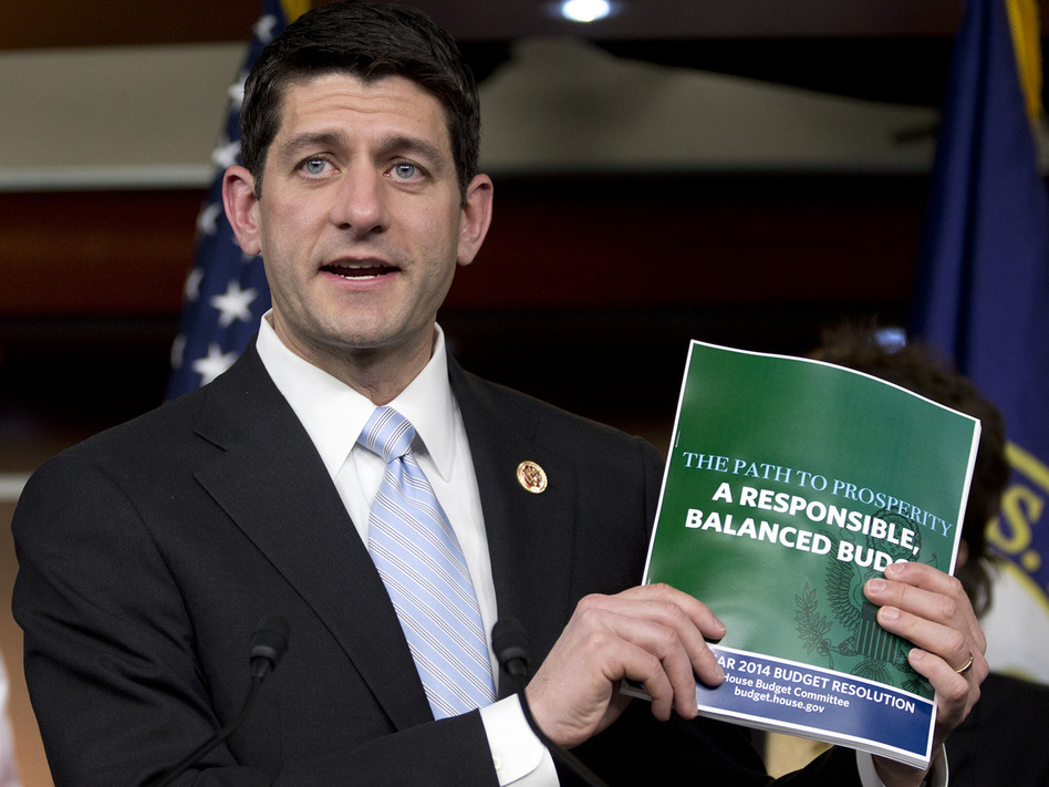 House Budget Committee Chairman Rep. Paul Ryan, R-Wis., holds up a copy of the 2014 Budget Resolution as he speaks during a news conference on Capitol Hill in Washington, Tuesday, March 12, 2013. (Carolyn Kaster/AP)