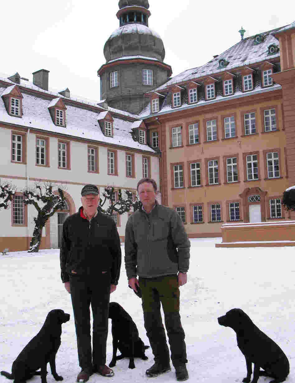 Prince Richard (left) and his son, Prince Gustav, stand in front of their palace in Bad Berleburg. The elder prince decided to reintroduce wisents into the wild in Germany a decade ago, but opponents and red tape hampered his efforts until recently.