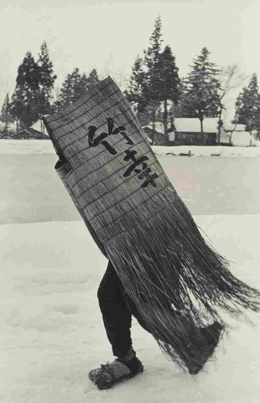 Man in a Traditional Minobashi Raincoat, Niigata Prefecture, 1956