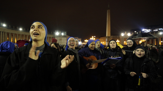 As the black smoke rose from the Vatican chimney Tuesday, some of the nuns and others gathered in St. Peter's Square were singing. (Reuters /Landov)