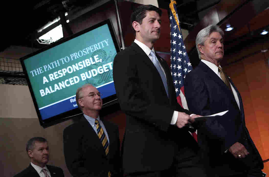 Rep. Paul Ryan (R-WI) (second from right), arrives with other GOP members of the House Budget Committee he chairs, for a news conference, March 12, 2013.