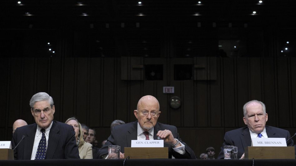 Director of National Intelligence James Clapper (center), accompanied by FBI Director Robert Mueller (left) and CIA Director John Brennan, testifies on Capitol Hill on Tuesday. (AP)