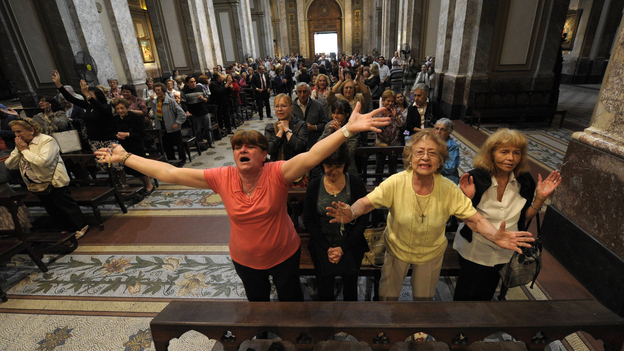 Faithful react after the announcement that Buenos Aires archbishop Jorge Mario Bergoglio was elected Pope Francis I, at Metropolitan Cathedral in Buenos Aires on Wednesday. (AFP/Getty Images)