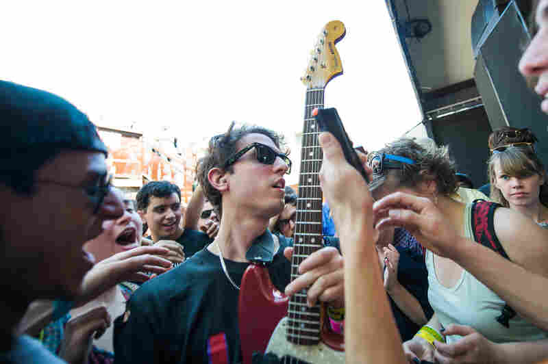 On the opening day of the SXSW music festival in Austin, Texas, a member of Beach Fossils jumps into the crowd at The Mohawk.